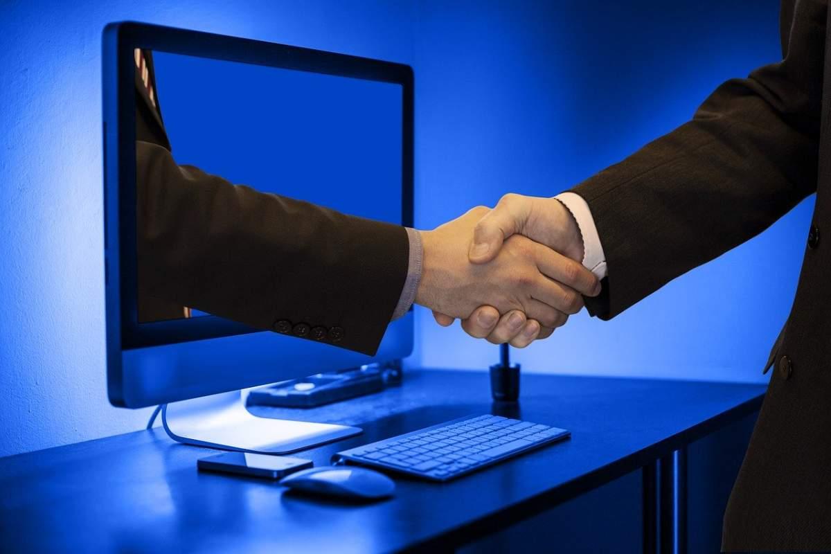 handshake-hands-monitor-online